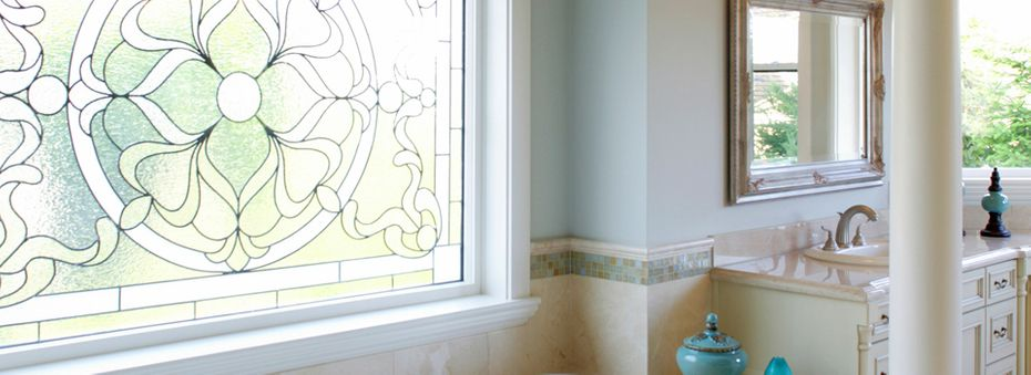 Bathroom with stylized glass window